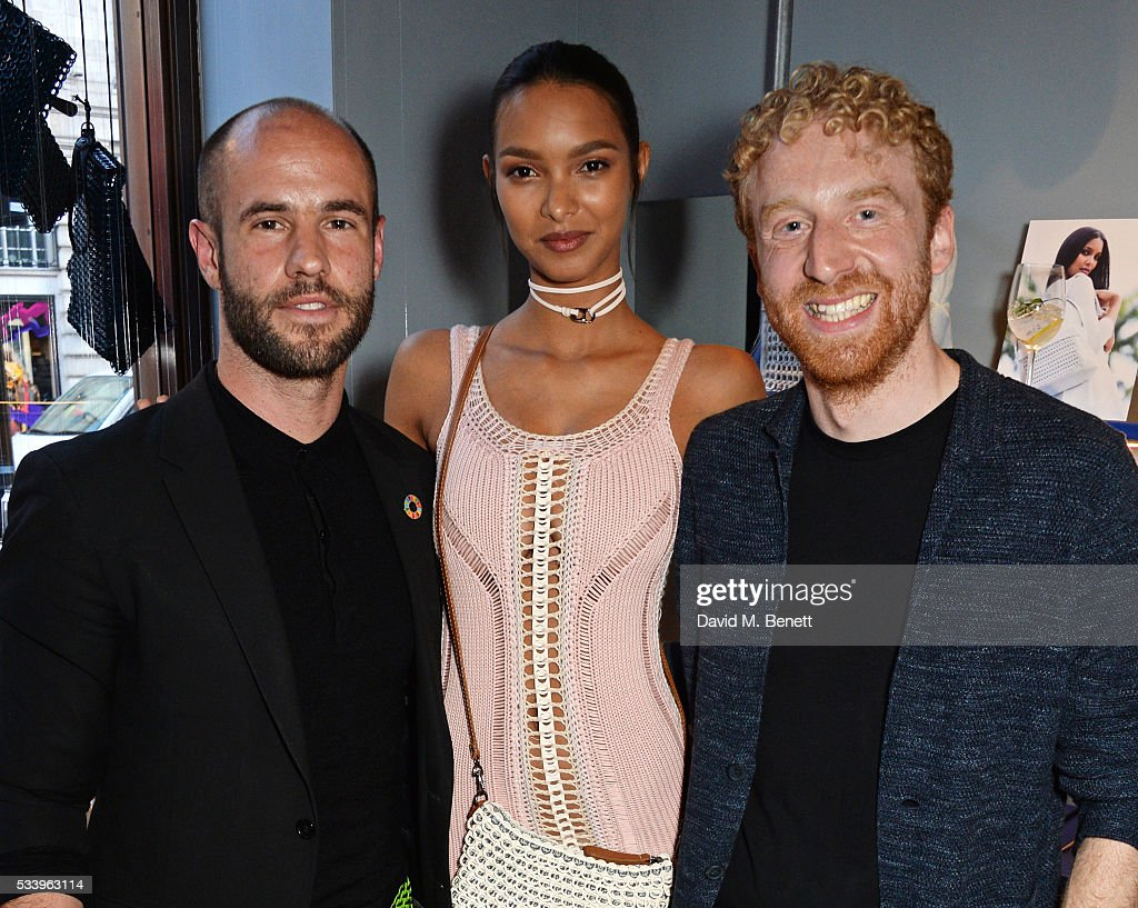 Model Lais Ribeiro (C) poses with Bottletop founders Cameron Saul (L) and Oliver Wayman at the Bottletop Regent Street store launch on May 24, 2016 in London, England.