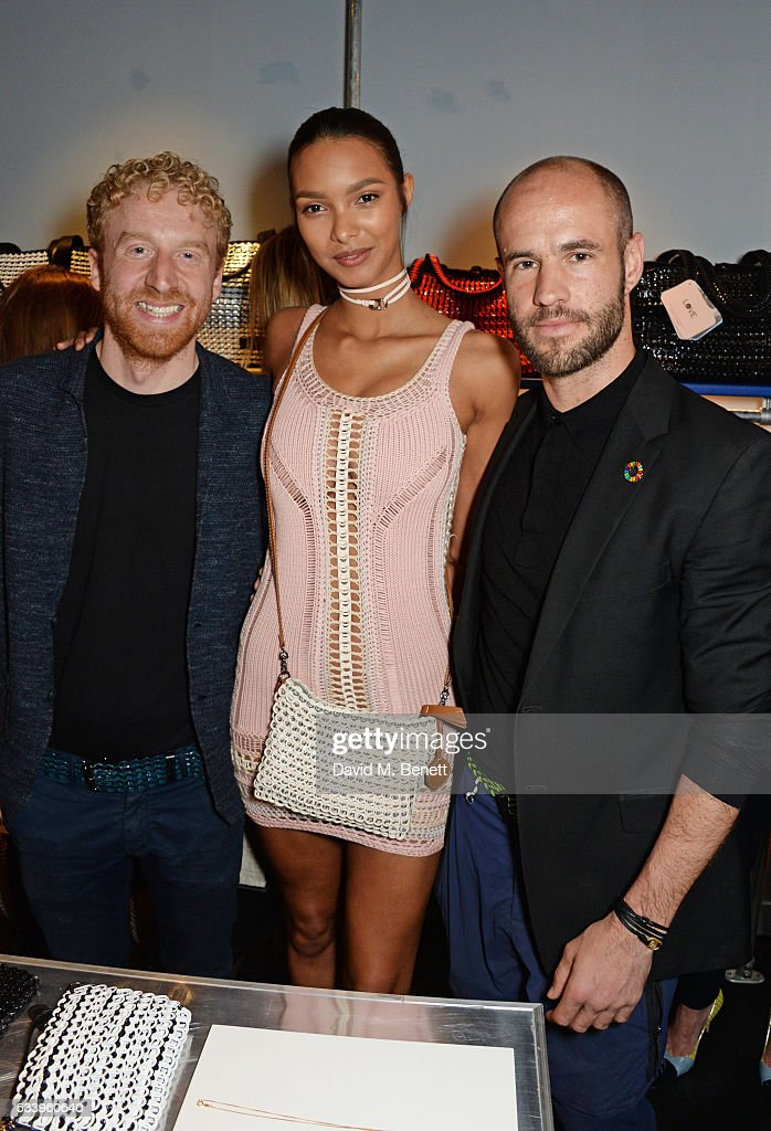 Model Lais Ribeiro (C) poses with Bottletop founders Oliver Wayman (L) and Cameron Saul at the Bottletop Regent Street store launch on May 24, 2016 in London, England.