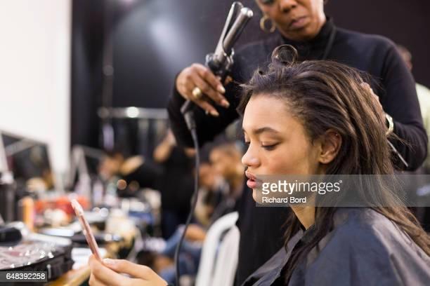 Model Lameka Fox prepares backstage before the Akris show at Palais de Tokyo as part of the Paris Fashion Week Womenswear Fall/Winter 2017/2018 on...
