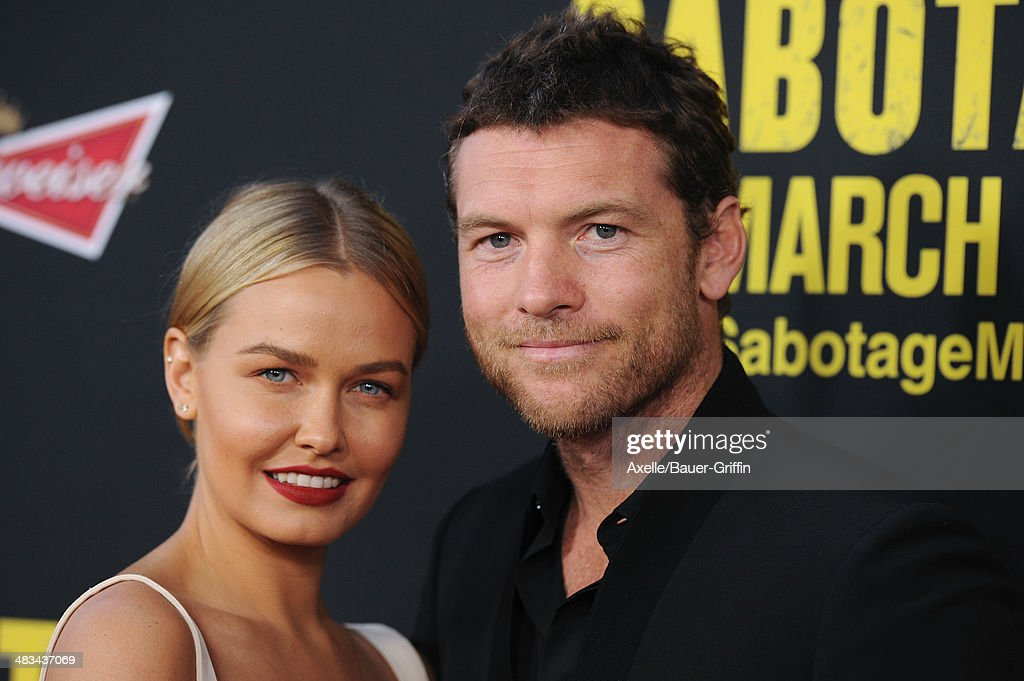 Model <a gi-track='captionPersonalityLinkClicked' href=/galleries/search?phrase=Lara+Bingle&family=editorial&specificpeople=553554 ng-click='$event.stopPropagation()'>Lara Bingle</a> and actor <a gi-track='captionPersonalityLinkClicked' href=/galleries/search?phrase=Sam+Worthington&family=editorial&specificpeople=2594426 ng-click='$event.stopPropagation()'>Sam Worthington</a> arrive at the Los Angeles premiere of 'Sabotage' at Regal Cinemas L.A. Live on March 19, 2014 in Los Angeles, California.