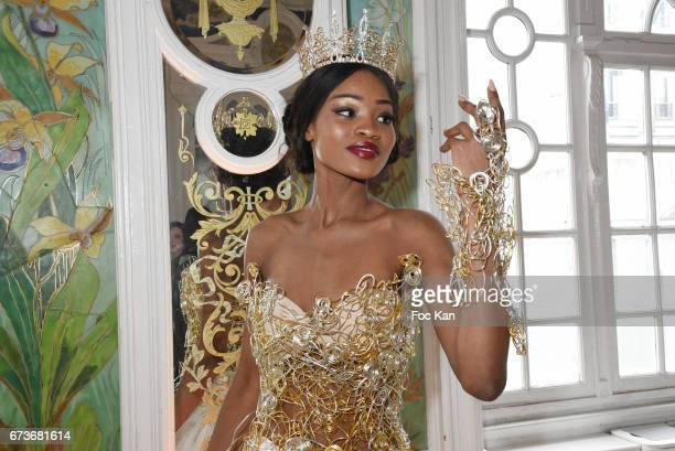 Model Lara Jalloh dressed by Katherine Derkeff poses during 'Fashion Night Couture 2017' Show at Salon des Miroirs on April 26 2017 in Paris France