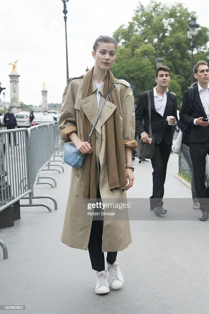 Model Larissa Hoffman wearing a Burberry trench coat, Miu Miu bag and Adida trainers day 3 of Paris Haute Couture Fashion Week Autumn/Winter 2014, on July 8, 2014 in Paris, France.