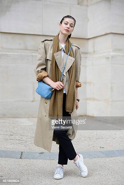 Model Larissa Hofmann poses wearing a Burberry trench Zara pants Adidas sneakers and Miu Miu bag after Chanel show on July 8 2014 in Paris France