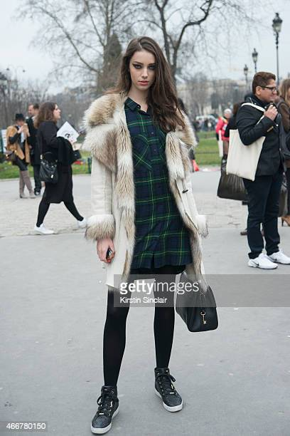 Model Larissa Marchiori wears an INC coat Dolce and Gabanna bag vintage dress and Michael Kors shoes on day 8 of Paris Collections Women on March 10...