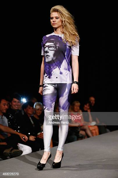 Model Larissa Marolt walks down the runway during the GarconF fashion show at BalloniHallen on August 5 2014 in Cologne Germany