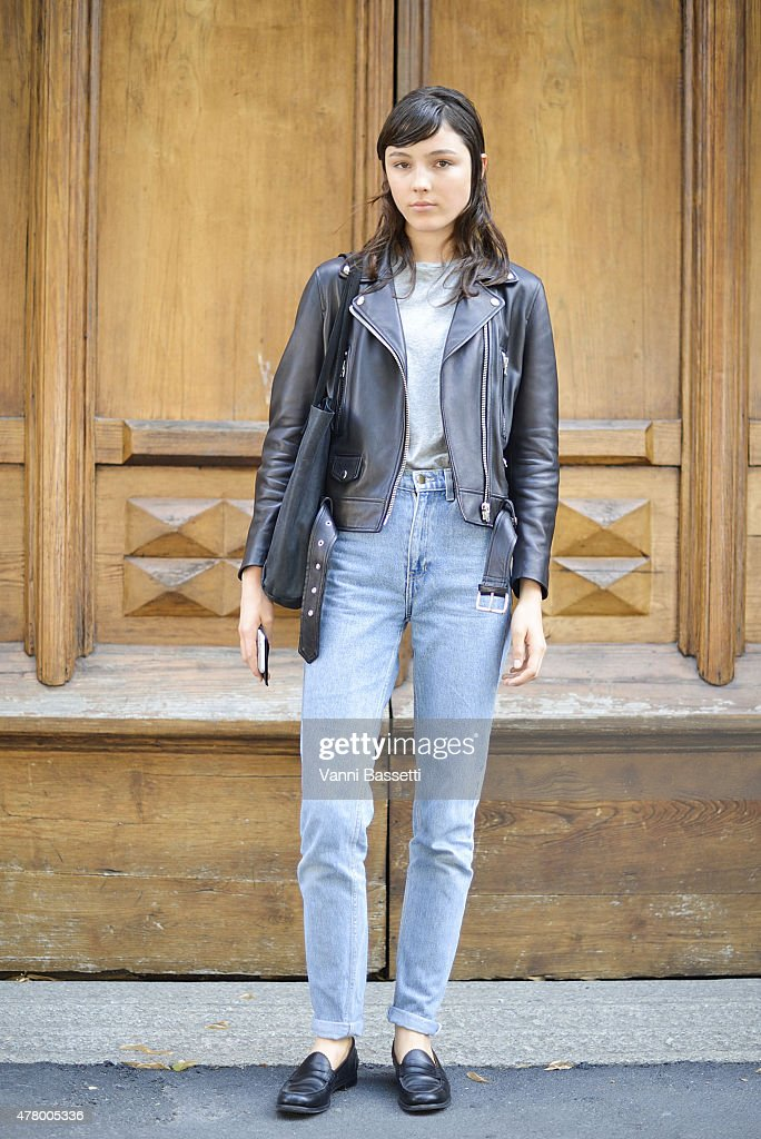 Model Lary Muller poses wearing Acne Studios leather jacket and American Apparel jeans on June 21 2015 in Milan Italy
