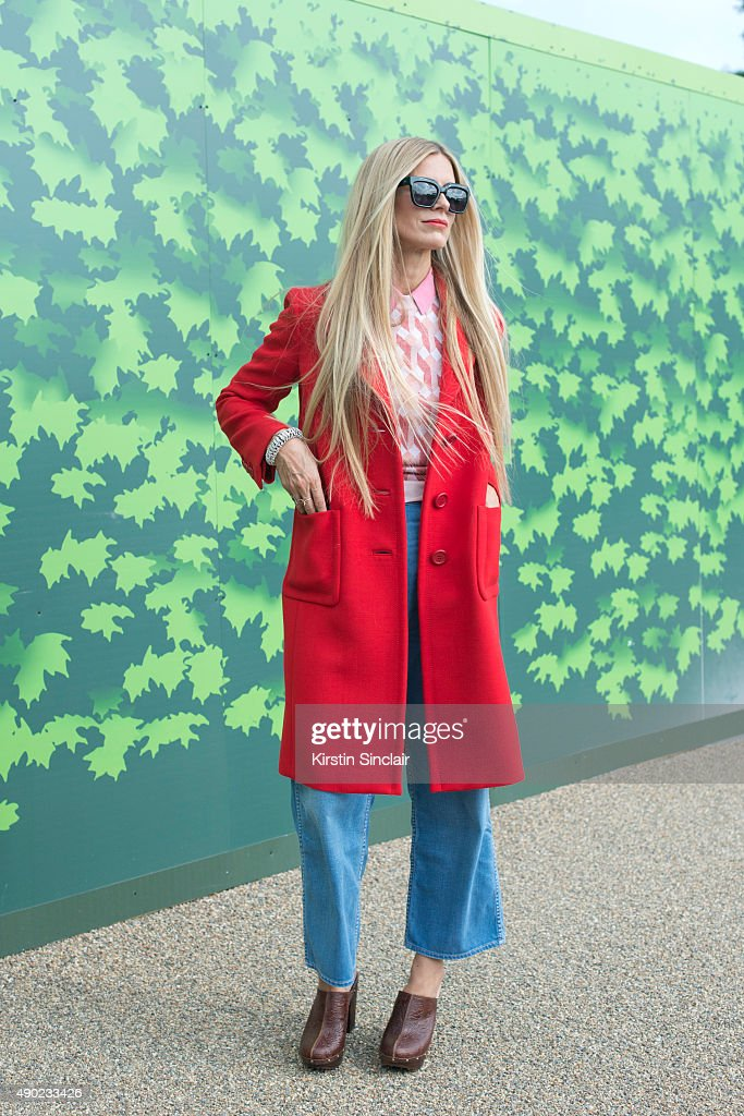 Model Laura Bailey wears a Prada coat Jonathan Saunders sweater vintage shirt Penelope Chilvers shoes Zanzan sunglasses and MiH jeans on day 3 during...