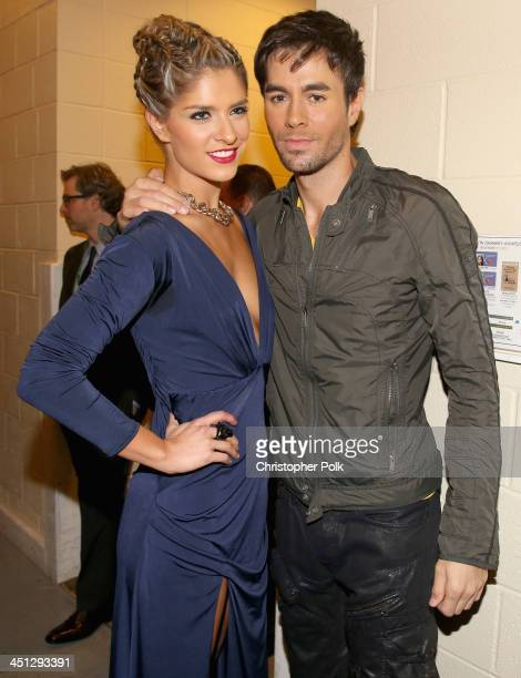 Model Laura Tobon and Enrique Iglesias pose backstage during the 14th Annual Latin GRAMMY Awards held at the Mandalay Bay Events Center on November...