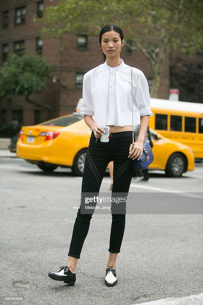 Model Leaf Zhang wears an Alexander Wang top Rag Bone jeans and Saint Laurent Paris flats on Day 6 of New York Fashion Week Spring/Summer 2015 on...