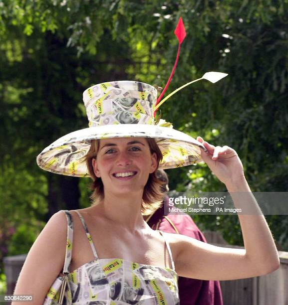 Model LeighAnne Tucker in a outfit made of money to celebrate the abolition of the betting tax as she arrives for the 3rd day of Royal Ascot 2001