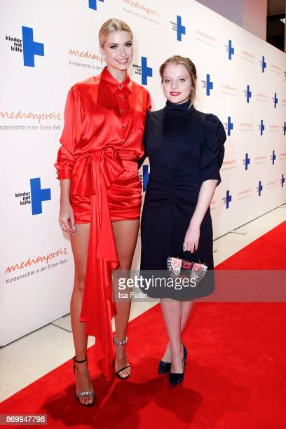 Model Lena Gercke and German actress Jella Haase attend the 19th Media Award by Kindernothilfe on November 3 2017 in Berlin Germany