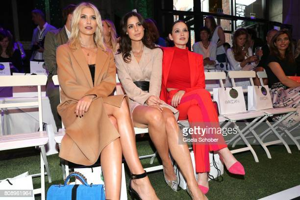Model Lena Gercke Lena MeyerLandrut and Emilia Schuele during the Marc Cain Fashion Show Spring/Summer 2018 at ewerk on July 4 2017 in Berlin Germany