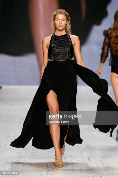 Model Lena Gercke walks the runway at the Felder Felder show during MercedesBenz Fashion Days Zurich 2013 on November 13 2013 in Zurich Switzerland