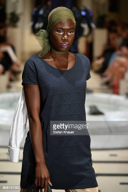 Model Leticia WalaNtuba walks the runway at the Anja Gockel show during the MercedesBenz Fashion Week Berlin Spring/Summer 2018 at Hotel Adlon on...