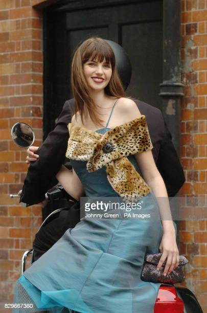 Model Lia Bishop from Premier Model Management wears a Per Una beaded corset dress leopard stole and beaded clutch with flower detail 'Per Una at...