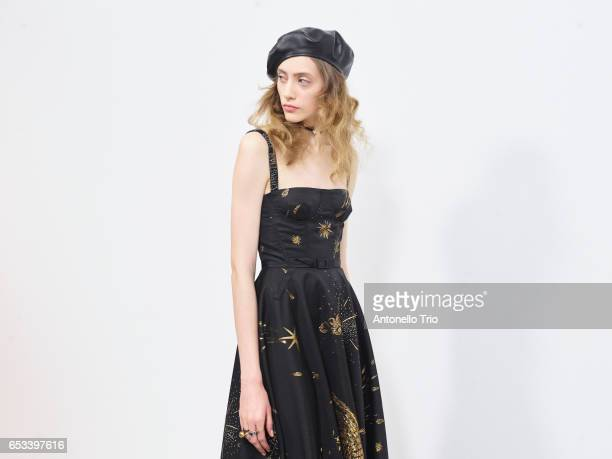 Model Lia Pavlova prepares backstage before the Christian Dior show as part of the Paris Fashion Week Womenswear Fall/Winter 2017/2018 on March 3...