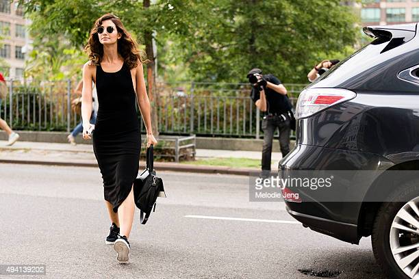 Model Lily Aldridge exits the Diane Von Furstenberg show at Spring Studios on September 13 2015 in New York City Lily wears metal circular sunglasses...
