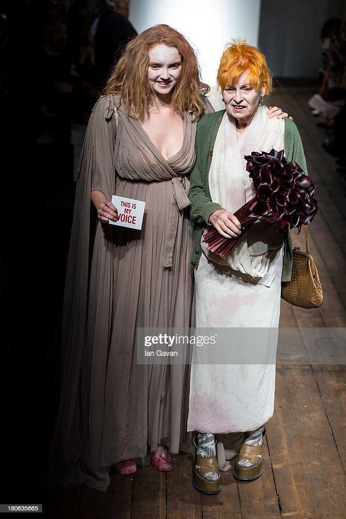 Model <a gi-track='captionPersonalityLinkClicked' href=/galleries/search?phrase=Lily+Cole&family=editorial&specificpeople=206320 ng-click='$event.stopPropagation()'>Lily Cole</a> and designer Dame Vivienne Westwood stand on stage after the Vivienne Westwood Red Label show during London Fashion Week SS14 at the German Gymnasium on September 15, 2013 in London, England.