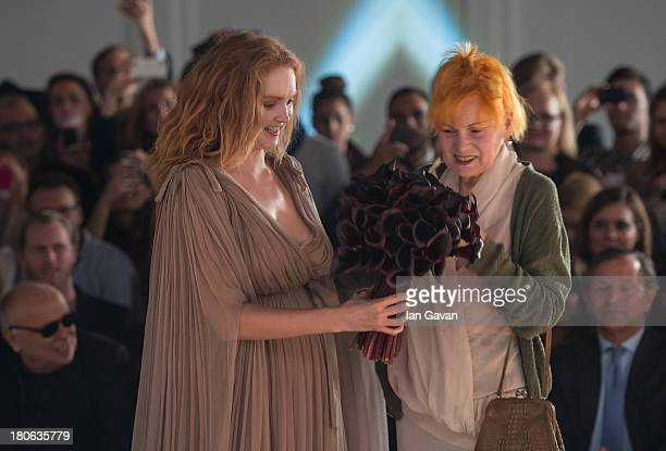 Model Lily Cole and designer Dame Vivienne Westwood stand on stage after the Vivienne Westwood Red Label show during London Fashion Week SS14 at the...