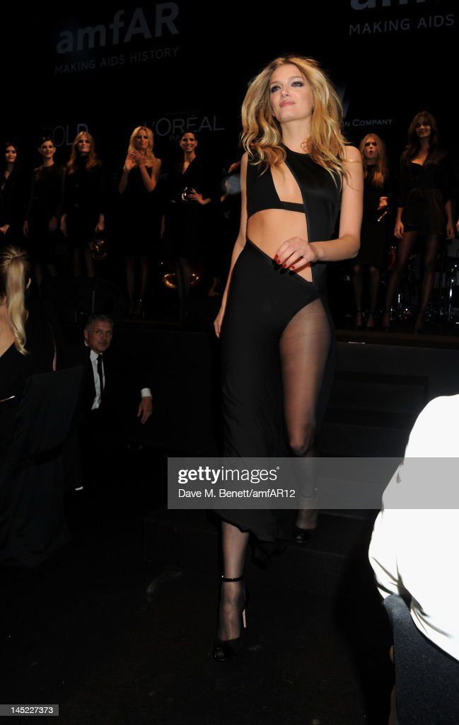 Model Lily Donaldson walks the runway during the 2012 amfAR's Cinema Against AIDS during the 65th Annual Cannes Film Festival at Hotel Du Cap on May 24, 2012 in Cap D'Antibes, France.