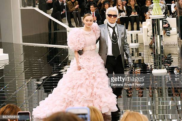 Model LilyRose Depp and Stylist Karl Lagerfeld acknowledge the applause of the audience at the end of the Chanel Spring Summer 2017 show as part of...