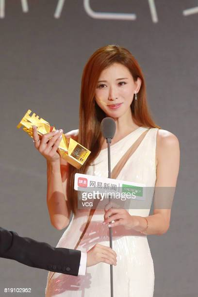 Model Lin Chiling poses with her trophy during the 2017 NetEase Entertainment Ceremony on July 19 2017 in Beijing China