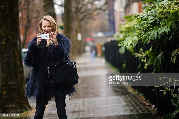 Model Lina Berg photographs the street style photographers during London Fashion Week Fall/Winter 2015/16 at Tate Britan on February 22 2015 in...