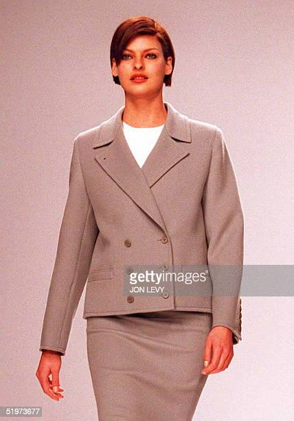 Model Linda Evangelista wears a beige skirt suit with doublebreasted jacket over a white roundneck shirt during the Calvin Klein Fall 1995 fashion...
