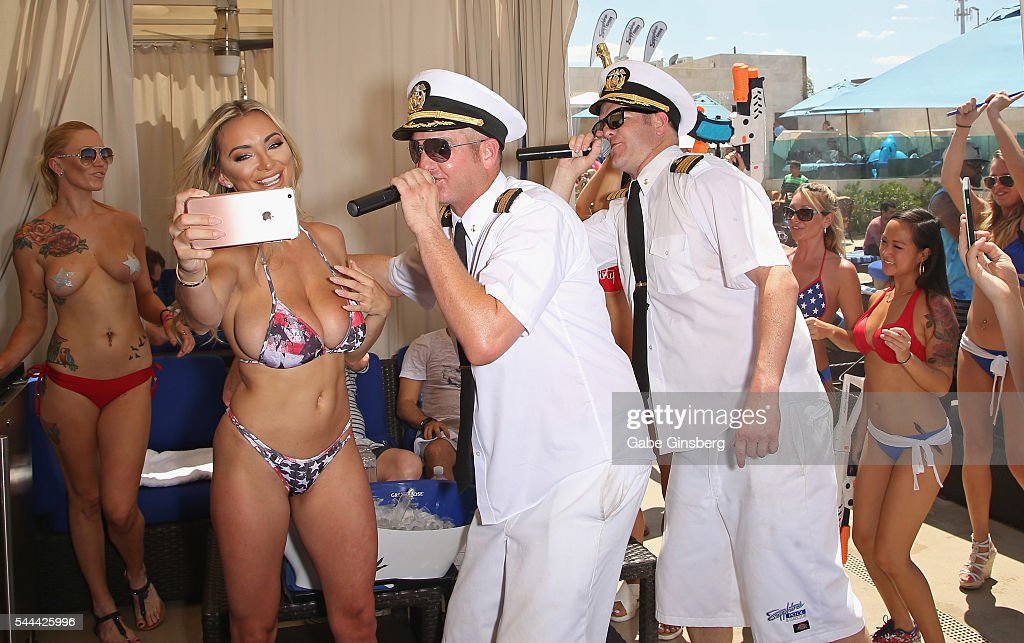Model Lindsey Pelas (2nd L) records rappers Danny Boy (3rd L) and Jimbo (4th L) of HardNox during their performance at the Sapphire Pool & Day Club on July 3, 2016 in Las Vegas, Nevada.