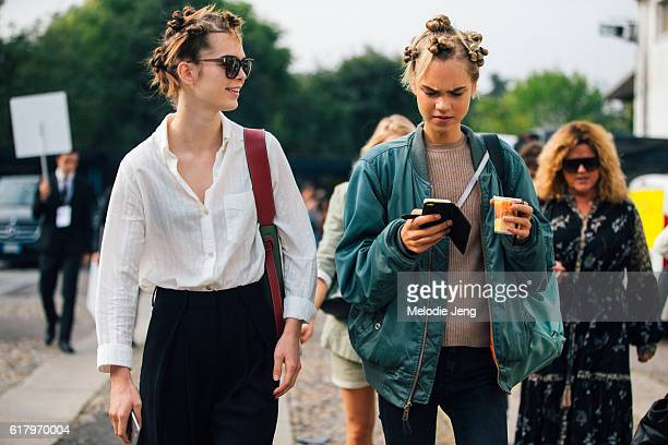 Model Line Brems wears a green bomber jacket and checks her phone after the Diesel Black Gold show during Milan Fashion Week Spring/Summer 2017 on...