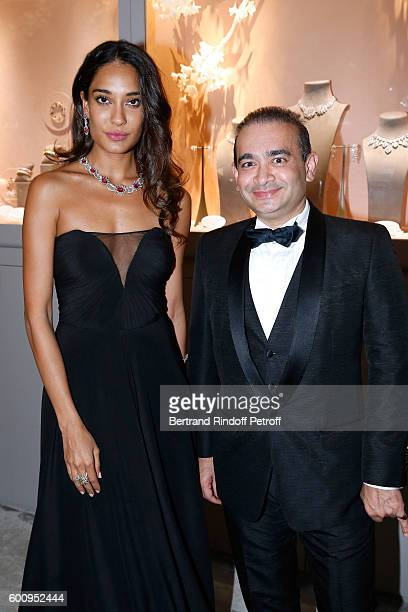Model Lisa Haydon and jeweller Nirav Modi attend the 28th Biennale des Antiquaires PreOpening at Grand Palais on September 8 2016 in Paris France