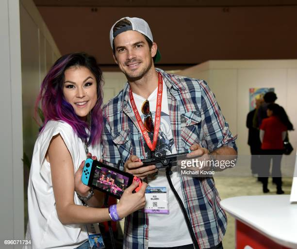 Model Lisa Malambri and actor Rick Malambri visit the Nintendo booth at the 2017 E3 Gaming Convention at Los Angeles Convention Center on June 14...