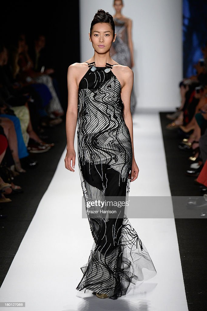 Model <a gi-track='captionPersonalityLinkClicked' href=/galleries/search?phrase=Liu+Wen&family=editorial&specificpeople=5523814 ng-click='$event.stopPropagation()'>Liu Wen</a> walks the runway at the Carolina Herrera fashion show during Mercedes-Benz Fashion Week Spring 2014 at The Theatre at Lincoln Center on September 9, 2013 in New York City.