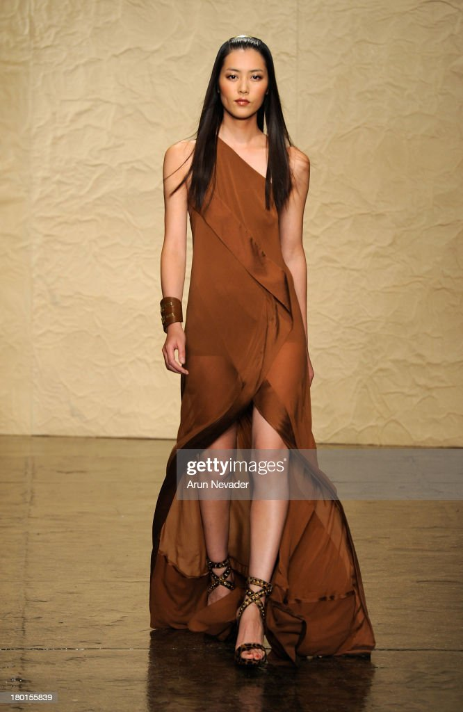 Model <a gi-track='captionPersonalityLinkClicked' href=/galleries/search?phrase=Liu+Wen&family=editorial&specificpeople=5523814 ng-click='$event.stopPropagation()'>Liu Wen</a> walks the runway at the Donna Karan New York fashion show during Mercedes-Benz Fashion Week Spring 2014 on September 9, 2013 in New York City.