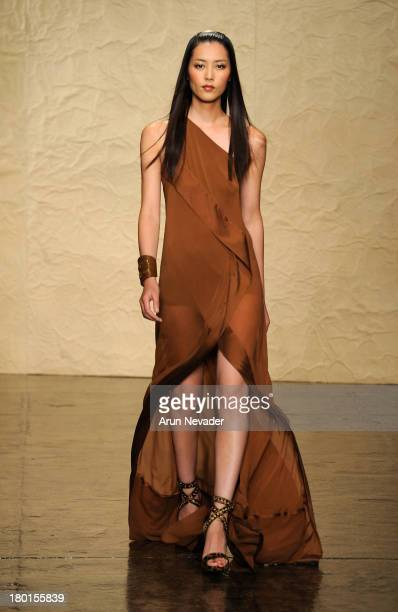 Model Liu Wen walks the runway at the Donna Karan New York fashion show during MercedesBenz Fashion Week Spring 2014 on September 9 2013 in New York...