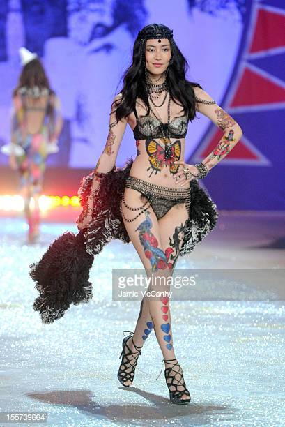 Model Liu Wen walks the runway during the 2012 Victoria's Secret Fashion Show at the Lexington Avenue Armory on November 7 2012 in New York City
