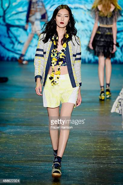Model Liu Wen walks the runway wearing Anna Sui Spring 2016 during New York Fashion Week The Shows at The Arc Skylight at Moynihan Station on...