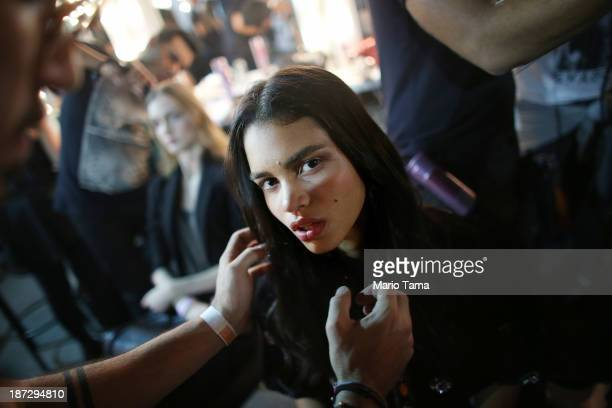 A model looks at the camera backstage while preparing for the Iodice fashion show at Fashion Rio Winter 2014 at Pier Maua on November 7 2013 in Rio...