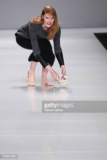 A model loses her shoe while walking the runway during the Line Knitwear fashion show during World Mastercard fashion week on March 17 2014 in...