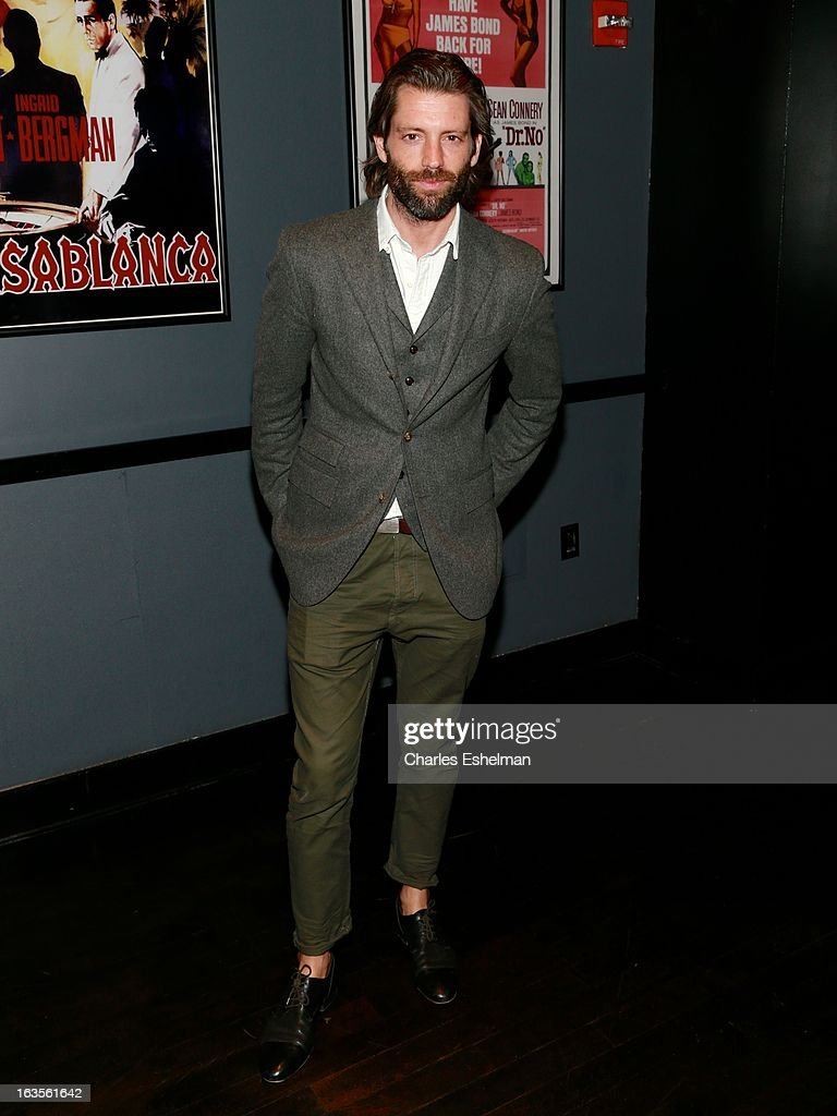 Model Louis Dowler attends The Cinema Society with Roger Dubuis and Grey Goose screening of FilmDistrict's 'Olympus Has Fallen' at the Tribeca Grand Screening Room on March 11, 2013 in New York City.