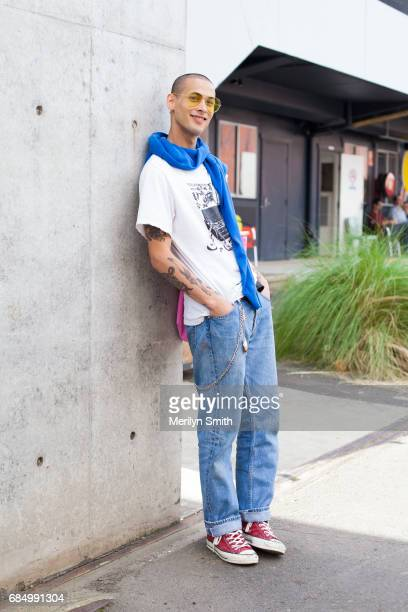 Model Luca Kiripun wearing vintage sunglasses Number 9 tshirt Comme Des Garcon bag Undercover sweater Levi jeans and Converse shoes during...
