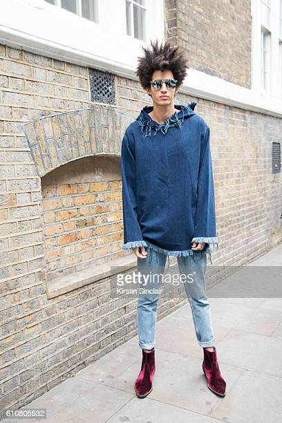 Model Luis Borges who wears a Marques Almeida top HM jeans Topman shoes and Dior sunglasses on day 5 of London Womens Fashion Week Spring/Summer 2016...