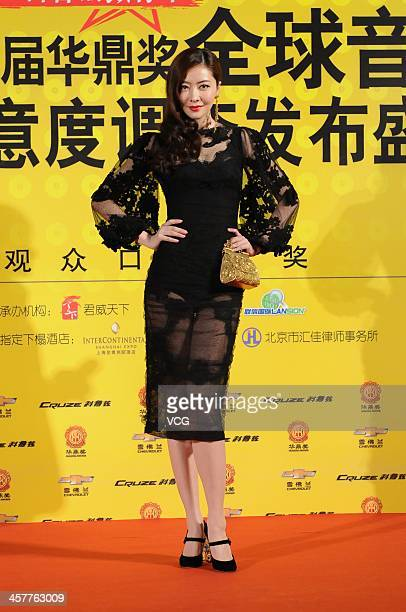 Model Lynn Xiong attends the 11th Huading Global Music Satisfaction Survey Release Ceremony at Shanghai Expo Centre on December 18 2013 in Shanghai...
