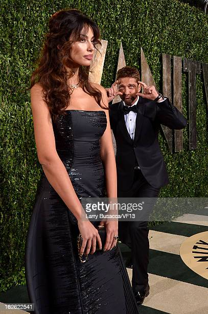 Model Madalina Ghenea and actor Gerard Butler arrive for the 2013 Vanity Fair Oscar Party hosted by Graydon Carter at Sunset Tower on February 24...