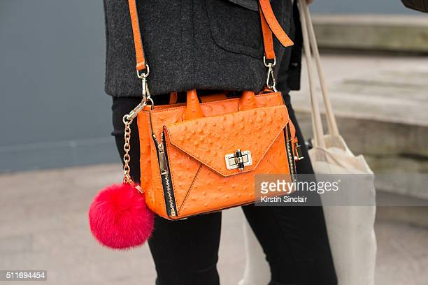 Model Madison Stubbington wears a Diane Von Furstenberg bag on day 3 during London Fashion Week Autumn/Winter 2016/17 on February 21 2016 in London...