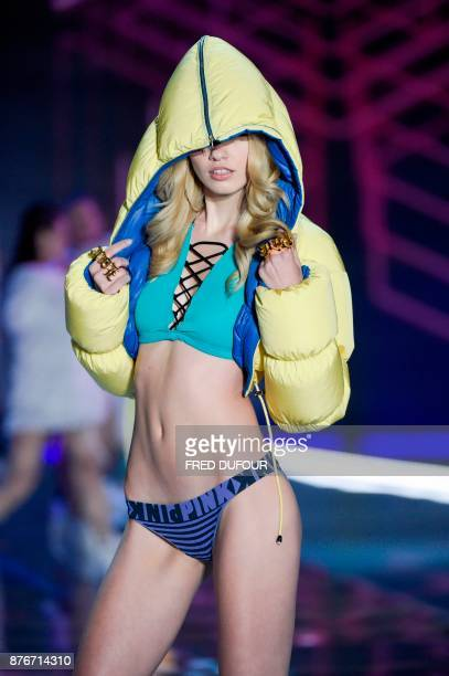 US model Maggie Laine presents a creation during the 2017 Victoria's Secret Fashion Show in Shanghai on November 20 2017 / AFP PHOTO / FRED DUFOUR /...