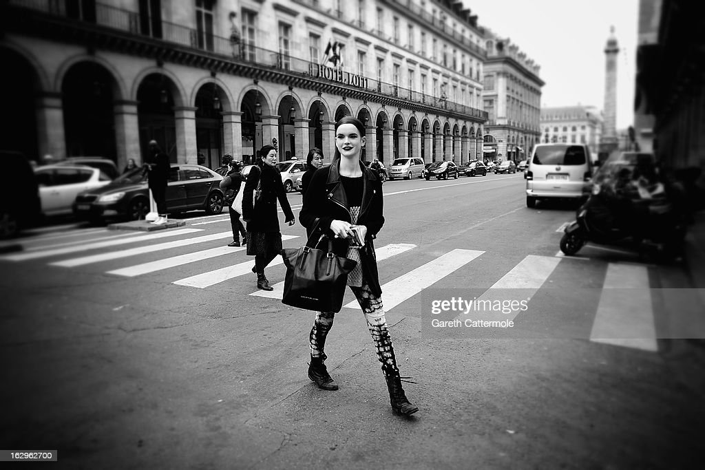 A model makes her way between shows during Paris Fashion Week on March 2, 2013 in Paris, France.