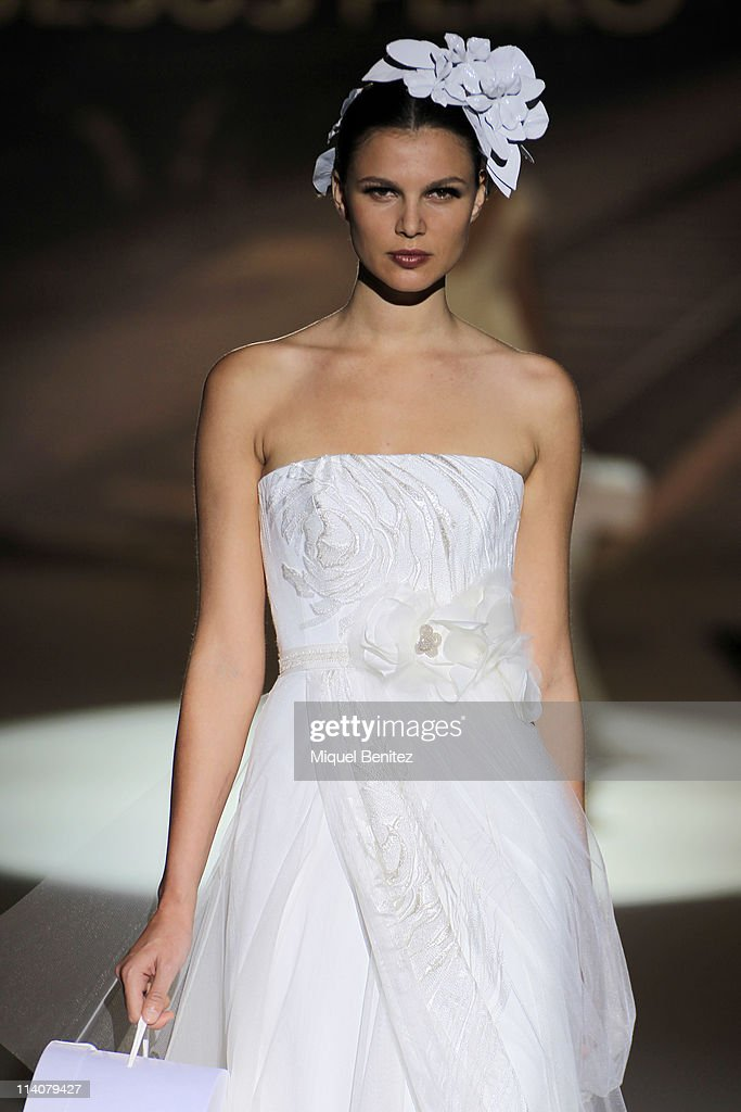 Model Malena Costa girl friend of FCBarcelona football player Carles Puyol walks the runway at a presentation of the new bridal collection by Jesus...