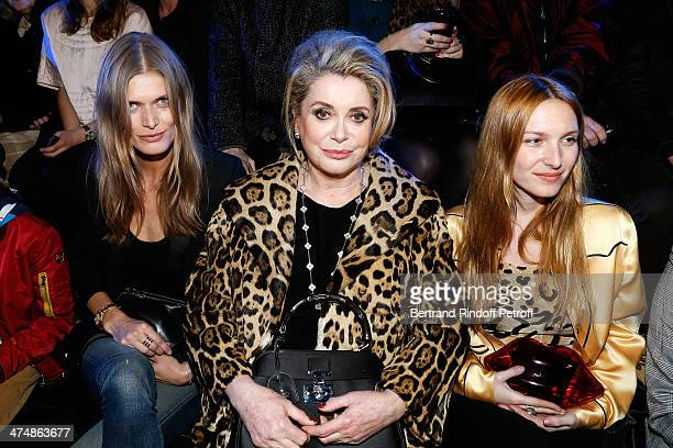 Model Malgosia Bela actress Catherine Deneuve and Joséphine de La Baume attend ETAM show as part of the Paris Fashion Week Womenswear Fall/Winter...
