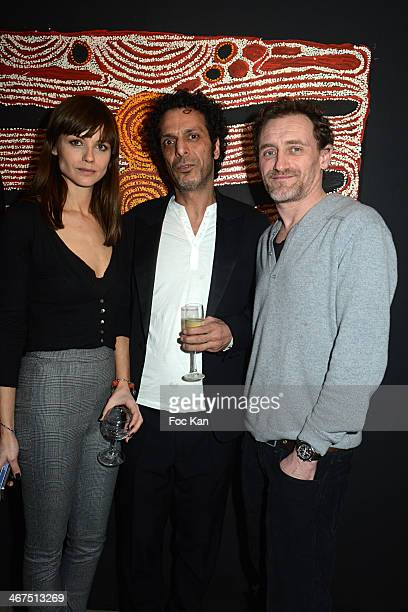 Model Mallory Betting Art Roch Galerie director Morteza Esmaili and Jean Paul Rouve attend the '3 Events in 1 Night' Galerie Art Roch Launch Party At...